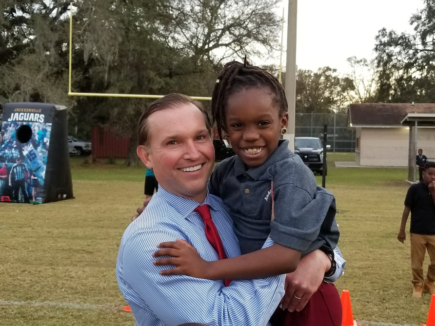 Mayor Lenny Curry with a student from Big Brothers Big Sisters at the Kooker Park ribbon cutting, Dec. 14, 2017.